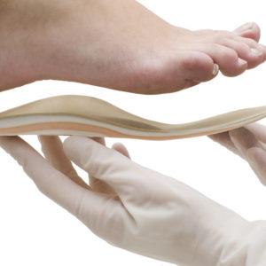 Orthopedic insoles isolated on white background